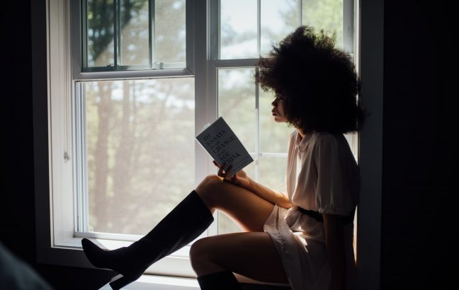 black woman reading book